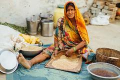 Woman Cleaning Rice, Sidhi India (AdamCohn) Tags: adam cohn madhya pradesh india satna baskets portrait rice sari streetphotographer streetphotography wwwadamcohncom adamcohn madhyapradesh inexplore explored explore