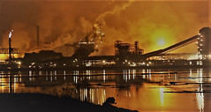 Zug Island is a highly guarded, coal burning,  smoke belching, fire-spewing wasteland which exists downriver from Detroit. Most of the plants are owned by US Steel. At night, it makes for quite a hellish view. The smell is indescribable! (wavz13) Tags: vintageindustry oldindustry vintageindustrial oldindustrial vintagefactory oldfactory vintagefactories oldfactories urbandecay urbanwasteland urbanblight industry industrial industrialwasteland wasteland bleak bleakwasteland pollution polluted brownfield brownfields pollutedwasteland dystopia dystopic steelmills oldsmokestacks oldsmokestack smokestacks smokestack abandonedwasteland urbanruins heavyindustry surreal