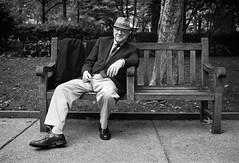Gentleman in the Park (Dalliance with Light (Andy Farmer)) Tags: monochrome ilfordhp5 philly rittenhousesquare hc110dilb fujifilmgw690ii analog bw street film philadelphia pennsylvania unitedstatesofamerica portrait