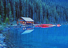 Early morning on Lake Louise (ashockenberry) Tags: canada reserve rocky mountains majestic mountain landscape lake beautiful beauty canoe red early morning dawn alberta nature naturephotography natural ashleyhockenberryphotography reflection still water serene scenic scenery
