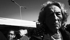 Faded glory. (Baz 120) Tags: candid candidstreet candidportrait city contrast street streetphoto streetcandid streetportrait strangers rome roma ricohgrii europe women monochrome monotone mono noiretblanc bw blackandwhite urban life portrait people provoke italy italia grittystreetphotography faces decisivemoment