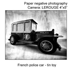 French police car, tin toy - This black and white camera obscura photo is NOT sharp due to camera characteristic. Taken on analogue photographic Kentmere Photographic Paper, Kenthene Glossy M.WT.2 - 2:50min - Developer: Tetenal Eukobrom AC 1:9 at ISO 6, w (jbeugephoto) Tags: police car french old vehicle emergency security black automobile white retro law transportation cop vintage auto protection safety crime symbol patrol classic protect sign model justice authority arrest antique serve nostalgia tin toy style small urban obscura photography film pinhole image beautiful scene manual perspective nostalgic photo camera scenic analogue analogphotography analog traditional photographic pinholecamera outoffocus blurry nolens lerouge large format 45 54 lerouge45 lerouge54 kentmere developer tetenal eukobrom glossy paper iso6