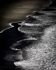 Silver and Black Water (Graeme O'Rourke) Tags: lrcf2f3708 colour blackandwhite bw sea water ocean sand white black waves beach silver reflections