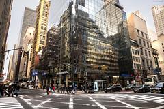 Reflections on a corner (ricardocarmonafdez) Tags: newyork manhattan cityscape urbanscape buildings skyscrapers reflejos reflections windows sunlight lighting shadows lights color nikon d850 ricardocarmonafdez ricardojcf people