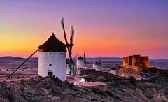 The Windmills of Consuegra. (Ian, Bucks) Tags: windmills sunset dusk evening hillside sky castle molinos castillo