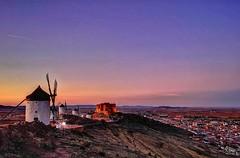 The Windmills of Consuegra. (Ian, Bucks) Tags: windmills panorama sunset evening dusk castle hillside town distant molinos castillo sky