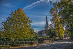 Autumnal view towards Godalming, Surrey (fotosforfun2) Tags: godalming surrey landscape england uk village autumn seasons colour church architecture building blue sky green yellow clouds steeple road fence