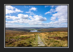 SJ2_2609 - Coming down from Top Withens (SWJuk) Tags: swjuk uk unitedkingdom gb britain england yorkshire westyorkshire calderdale haworth widdop walshawdean walshawdeanreservoirs hills hillside moors moorland heather grasses path footpath paved gorple bluesky clouds sky 2019 sep2019 autumn autumnal autumncolours nikon d7200 nikond7200 tokinaatx116prodxii1116mmf28 wideangle rawnef lightroomclassiccc landscape