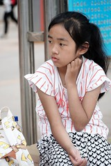 A young Chinese girl in Xingcheng village, Yunnan, China (adamba100) Tags: asia asian china chinese korea korean mongolia mongolian vietnam vietnamese thai beijing town city view landscape cityscape street life lifestyle style people human person man men woman women male female girl boy child children kid interesting portrait innocent cute charm pretty beauty beautiful innocence play face headshot pure purity tourism sightseeing tourist travel trip light color colour outdoor traditional cambodia cambodian phnom penh sony a6300 18105 siem reap pattaya bangkok field gate architecture tree building