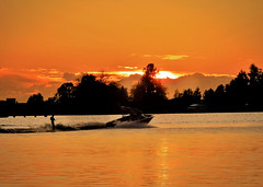 The Lake at Sunset (Clare-White) Tags: light sunset lake water amsterdam silhouette skier boat nature surfer activity