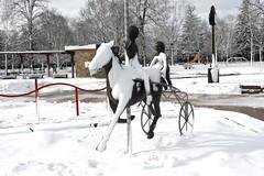 Statue of Racing Carousel Half Covered in Wet Snow, Dundas, Ontario (Joseph Hollick) Tags: dundas snow winter ontario statue snowcovered