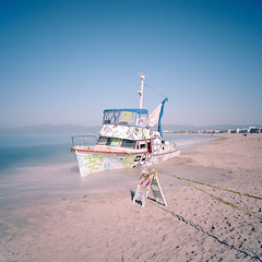 three hour tour. marina del rey, ca. 2019. (eyetwist) Tags: eyetwistkevinballuff eyetwist boat aground abandoned marinadelrey pacificocean sand longexposure neutraldensity kodakportra160 ishootfilm ishootkodak mamiya 6mf 50mm kodak portra 160 mamiya6mf mamiya50mmf4l bw nd 110 10stop schneider filter analog analogue film emulsion mamiya6 square 6x6 mediumformat 120 primes filmexif epsonv750pro iconla lenstagger pacific ocean losangeles los angeles socal california westla angeleno waves horizon water seascape yacht beached drunkboating tagged graffiti vandalized litter cabin cruiser santamonicabay