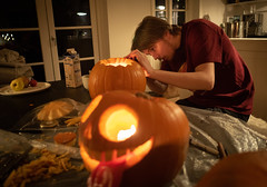 Preparing Halloween (2): More cutting (bohelsted) Tags: halloween home rødovre family leicadg15mm summilux em5markii leicadg lowkey lowlight pumpkin