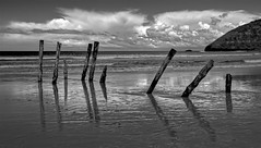 The poles of St Clair (Ian@NZFlickr) Tags: poles stclair beach st clouds sun reflection dunedin nz clair