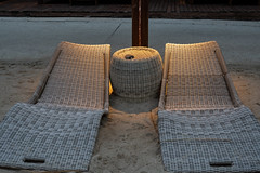 Legian, Bali / Indonesia April 19, 2019  Bali resort swimming pool loungers empty at night (stewart.watsonnz) Tags: chair furniture wood architecture seat wicker noperson couch sofa tree cushion family armchair tire monitor lcdscreen wovenfabric screen table flooring travel plant house pattern homedecor interiordesign outdoorfurniture pillow design beige hardwood empty wool woven flagstone beach promontory relaxation plywood abandoned patio light bench