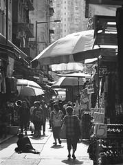 Marble Street, Hong Kong (a.pierre4840) Tags: olympus om3 zuiko 100mm f28 35mmfilm kodak kodaktrix streetphotography market shadows hongkong bw blackandwhite noiretblanc