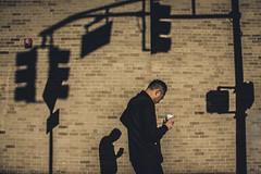 Signals From Your Dark Passenger (Creekside Photog) Tags: man coffee shadow light wall brick newjersey streetphotography newbrunswick conceptual