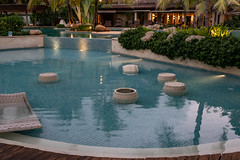 Legian, Bali / Indonesia April 19, 2019  Bali resort swimming pool empty at night (stewart.watsonnz) Tags: resort water swimmingpool building hotel vacation leisure pool patio garden villa chair dugoutpool property outdoor table noperson green reflectingpool sitting outdoors poolside waterfeature swimming resorttown small recreation luxury realestate umbrella pottedplant travel backyard bench games jar relaxation large pottery spatown park nature landscape street yard clock porch architecture