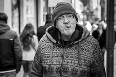 Cheeky (Leanne Boulton) Tags: urban street candid portrait portraiture streetphotography candidstreetphotography candidportrait streetportrait eyecontact candideyecontact streetlife old man male face eyes expression mood tongue emotion feeling cheeky fun funny humour humorous beanie autumn sweater character tone texture detail depthoffield bokeh naturallight outdoor light shade city scene human life living humanity society culture lifestyle people canon canon5dmkiii 70mm ef2470mmf28liiusm black white blackwhite bw mono blackandwhite monochrome glasgow scotland uk