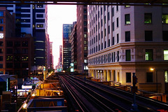 not there, but almost there (KevinIrvineChi) Tags: authority buildings canyon chicago cta disappearing downtown dunkindonuts el greekkitchen grk heavyrail illinois l lit loop railroad streetlight sunset terracotta tracks train transit urban canon powershot g7x mark 2 ii