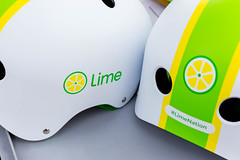 Close-up of the Lime e-scooter logo and #LimeNation hashtag on two white helmets with green and yellow graphics (verchmarco) Tags: köln digital19 kölnmesse digitalx telekom noperson keineperson glazed glasiert business geschäft graphicdesign grafikdesign spherical sphärisch isolated isoliert paper papier internet industry industrie creativity kreativität contemporary zeitgemäs conceptual konzeptionelle luck glück technology technologie wealth reichtum achievement leistung financialsecurity finanziellesicherheit horizontal 2019 2020 2021 2022 2023 2024 2025