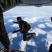 U.S. Marines conduct parachute operations by jumping out of a KC-130 Hercules on Ie Shima, Okinawa