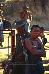 Kyaiktiyo, Burmese soldiers (blauepics) Tags: myanmar birma burma southeast asia südostasien 1996 kyaiktiyo kyaiktio mountains berge village dorf bergdorf army armee outpost ausenposten defence verteidigung burmese birmanische soldiers soldaten men männer rifle gewehr gun arms waffen candid