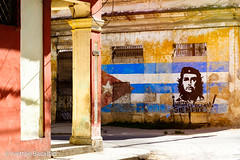 Image of Che Guevara and a cuban flag on an old decaying building in Havana (ivetthe1) Tags: cuba havana aged america american ancient antique architecture argentine attraction building capital caribbean che cheguevara city cityscape colorful communism communist cuban decay destination ernesto famous flag grunge grungy guerrilla guevara historic history icon iconic latin latinamerica marxism marxist mural old oldhavana painting political politics revolution revolutionary shabby slogan socialism socialist street symbol urban vintage wall weathered