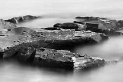 Edges (John Westrock) Tags: blackandwhite longexposure lakesuperior smooth rocks nopeople outdoors horizontal canoneos5dmarkiii canonef135mmf2lusm johnwestrock