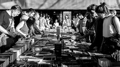 Words In Picture (Sean Batten) Tags: london england unitedkingdom southbank blackandwhite bw streetphotography street fujifilm x100f city urban books people candid reading marketstall