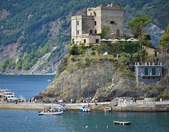 Torre Aurora castle (thomasgorman1) Tags: view fortress sea mediterranean nikon scenic italy coast shore boats people mountain travel tourism bay gulf hill hilltop