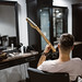 Man playing electric guitar in barber shop