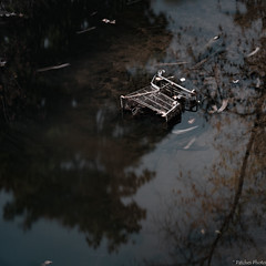 Cast Aside (Patches Photo) Tags: capitalism spill shopping kart abandoned trash fall reflection debris commercialism spooky