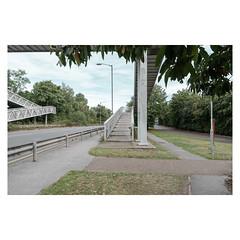 Pathways (John Pettigrew) Tags: lines tamron d750 nikon bridge roads mundane documentary urban imanoot banal topographics double ordinary deserted deolate angles yellow johnpettigrew footbridge