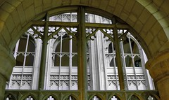 Symmetry: Perpendicular Gothic tracery, c1330 - Gloucester Cathedral, Gloucester, England. (edk7) Tags: nikond50 edk7 2007 uk england gloucestershire gloucester cathedralchurchofstpeterandtheholyandindivisibletrinity gloucestercathedral arch sculpture stonecarving ornamentation englishperpendiculargothictracery architecture building oldstructure church gradeilisted tracery window formerabbeychurch quatrefoil