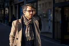 The Autumn Sun (Leanne Boulton) Tags: urban street candid portrait portraiture streetphotography candidstreetphotography candidportrait streetportrait streetlife man male handsome face eyes expression mood feeling beard glasses style fashion stylish dapper scarf autumn sunlight tone texture detail depthoffield bokeh naturallight outdoor light shade shadow city scene human life living humanity society culture lifestyle people canon canon5dmkiii 70mm ef2470mmf28liiusm colour glasgow scotland uk