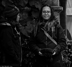 Candid isn't always covert. (Neil. Moralee) Tags: neilmoralee woman wome pair two talking eyecontact candid portrait girl olympus omd em5 neil moralee black white mono monochrome blackandwhite blackwhite bw smile spotted face dark beauty outdoor people knightshayes devon tiverton uk