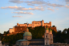 The Hohensalzburg fortress in evening glow (echumachenco) Tags: evening sunset sky blue cloud eveningpink glow castle fortress festung hohensalzburg hill hillside cathedral dom history architecture medieval baroque leonhardvonkeutschach wolfdietrich parislodron cupola spire city building salzburg austria österreich nikond3100