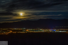 Moonlight Over Mesquite (Wycpl) Tags: moon mesquite nevada jcpphotography citylights clouds mountains