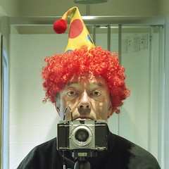 reflected self-portrait with Paxina 29 camera and clown hat (cropped) (pho-Tony) Tags: cameraselfportraits paxina29 kodakportra160 kpdak portra 160 tetenal c41 braun paxina 29 f29 german germany 6x6 mediumformat square film 120 analog analogue collapsible nuremberg braunnuremberg rollfilm 1953 bayreuth paxanar 75mm pronto prontoshutter 12975