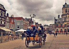 Travelling (mary.th) Tags: travel city cityscape delft holland people street urban house clouds carriage horses animals traditional tradition tourists
