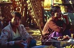 Kyaiktiyo, vendors (blauepics) Tags: myanmar birma burma southeast asia südostasien 1996 kyaiktiyo kyaiktio woman girl frau mädchen burmese birmanin faces gesichter light licht illumination beleuchtung lighting vendor market markt business geschäft smoking rauchen