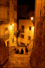 Under The Street Lamp   Blanes, Catalonia (Flemming J. Gade) Tags: youngsters kids children evening street streetlamp blanes catalonia
