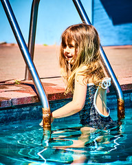Rosa, Labour Weekend 18 (ArdieBeaPhotography) Tags: kid child kindergarten blue red water pool swim concrete flags blonde onepiece swimsuit togs toobig bathers saggy overlarge test cold girl smile dark spring eyes little small sunny tentative patterned tamronaf70300mmf456divcusdif