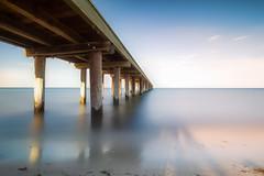 Seaford Pier (Thunder1203) Tags: beachesofaustralia morningtonpeninsula portphillipbay sea topazstudio calmsea daytime earlymorning landscape longexposure melbourne niceday nisifilters seascape weather seaford3198