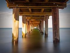 Under the pier (Thunder1203) Tags: beachesofaustralia morningtonpeninsula portphillipbay sea topazstudio calmsea daytime earlymorning landscape longexposure melbourne niceday nisifilters seascape weather seaford pier seafordpier