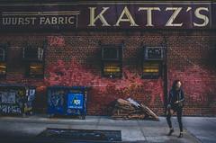 Some Chicks Are Just Kool Katz (Creekside Photog) Tags: newyorkcity eastvillage katzdeli street girl brick color grit grain usa america candidstreetphotography woman lady