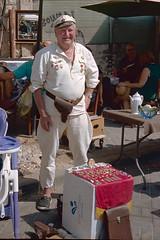Flea market, Haifa Israel (Howard Sandler (film photos)) Tags: fleamarket haifa israel street film portra rollei b35 35b 35 russian vendor