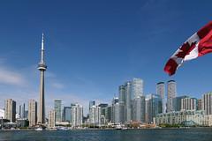 Toronto skyline. (Bernard Spragg) Tags: canada city cityscape skyline waterfront flag lumix travel sightseeing compactcamera ontario cco