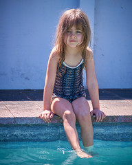 Rosa, Labour Weekend 22 (ArdieBeaPhotography) Tags: pool swim kid child kindergarten blue red water girl concrete flags blonde onepiece swimsuit togs toobig bathers saggy overlarge test cold smile dark spring eyes little small sunny tentative patterned tamronaf70300mmf456divcusdif